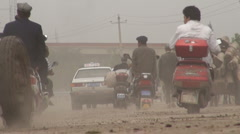 Dusty road filled with traffic in Kashgar - stock footage