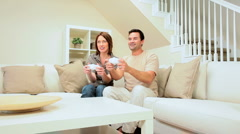 Caucasian Couple Competing on Games Console - stock footage