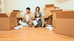 Young Couple Tired From House Moving - stock footage
