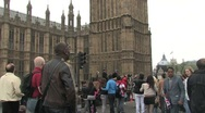 People walk to Royal Wedding in front of Police on horses Stock Footage
