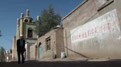 Mosque and Communist slogans in Western China Stock Footage