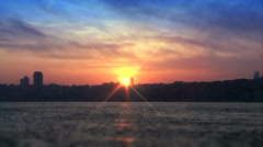 Sunset over coastal cityscape. Stock Footage