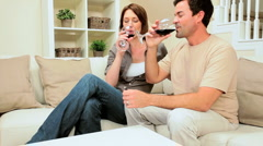 Young Couple Relaxing with a Glass of Wine - stock footage