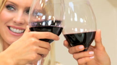Close up of Blonde Female Toasting Friends with Wineglass Stock Footage