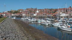 Whitby Marina, working and pleasure boats moored in sunshine Stock Footage