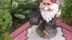 Approach of lamp in hands of the garden dwarf. Stock Footage