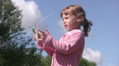 Little girl plays with toy plane and launch it. Stock Footage