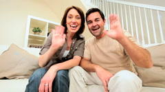 Happy Young Couple Using Online Internet Webchat Stock Footage