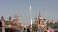 Group of helicopters fly with flags over Red Square. Stock Footage