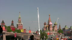 Over Red Square fly group of planes, people observe from below. Stock Footage