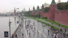 Participants run along quay near Kremlin on XXX MOSCOW INTERNATIONAL PEACE Stock Footage