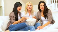 Girlfriends with Popcorn Watching Scary Movie Stock Footage