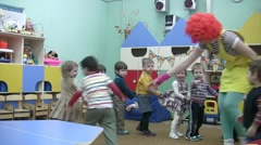 Children play with clown. Stock Footage
