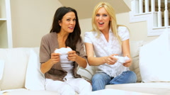 Young Girlfriends Playing on Games Console - stock footage