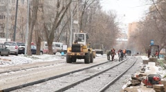 Workers repair road to city. Stock Footage