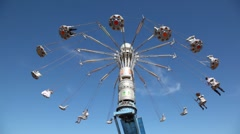 Merry-go-round on blue sky. - stock footage