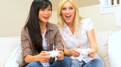 Multi-Ethnic Females Playing Electronic Games - stock footage