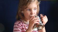 Little girl drinks tea in train. Stock Footage