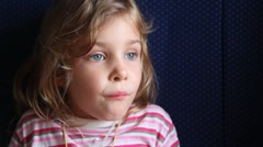 Little girl sits in train. Stock Footage