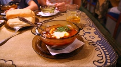 On table is bowl with borsch. Stock Footage