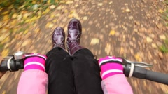 Girl sits on handlebar, rides with the father on bicycle. Stock Footage
