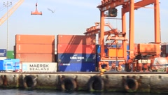 Container truck runs at sea port Stock Footage