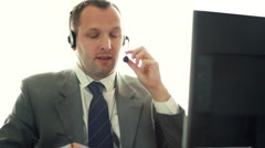 Male helpdesk consultant talking on headset HD Stock Footage