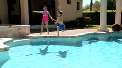 Young Siblings in Family Swimming Pool Stock Footage