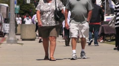 Obese Couple Walking Toward Camera Stock Footage