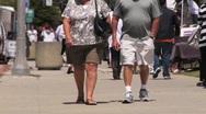 Obese Couple Walking Toward Camera Stock Footage