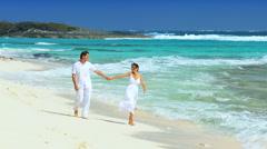 Attractive Couple Enjoying Paradise Beach Vacation Stock Footage
