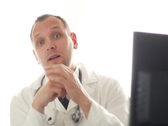 Male doctor talking to the camera NTSC Stock Footage