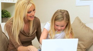 Stock Video Footage of Mom & Young Daughter Using Laptop Computer