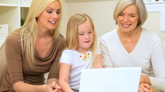 Three Female Generations Using Laptop Computer Stock Footage