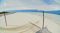 Hammock Swaying Over Tropical Beach in Wide-angle - stock footage