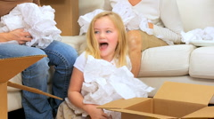 Family Females with Tissue from Moving Cartons Stock Footage