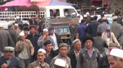 People returning home from the livestock market in Kashgar Stock Footage