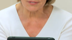 Mature Lady Using Wireless Tablet for Web-chat Stock Footage