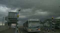 Bus & plane at Heathrow Airport on a cloudy day Stock Footage