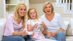 Cute Little Girl Playing Games Console with Family - stock footage