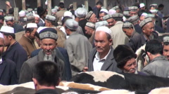 Livestock market trading in Kashgar, primitive economy, Western China, culture Stock Footage