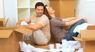 Couple Sitting on Floor of New Home Stock Footage