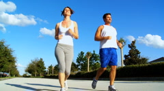 Young Couple Enjoying Jogging Exercise Stock Footage