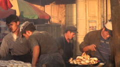 Kashgar, China, preparing fresh bread in beautiful soft colors Stock Footage