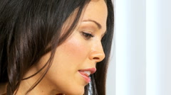 Face of Brunette Girl Looking Thoughtful Stock Footage