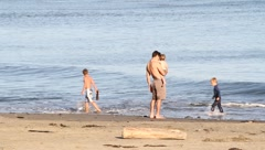 Dad and boys at beach Stock Footage