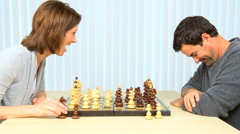 Young Caucasian Couple Playing Chess Stock Footage