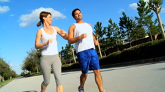 Active Couple on Exercise Programme - stock footage