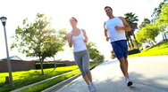 Stock Video Footage of Attractive Couple Jogging to Keep Fit