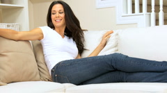 Young Girl Relaxing Alone on Couch Stock Footage